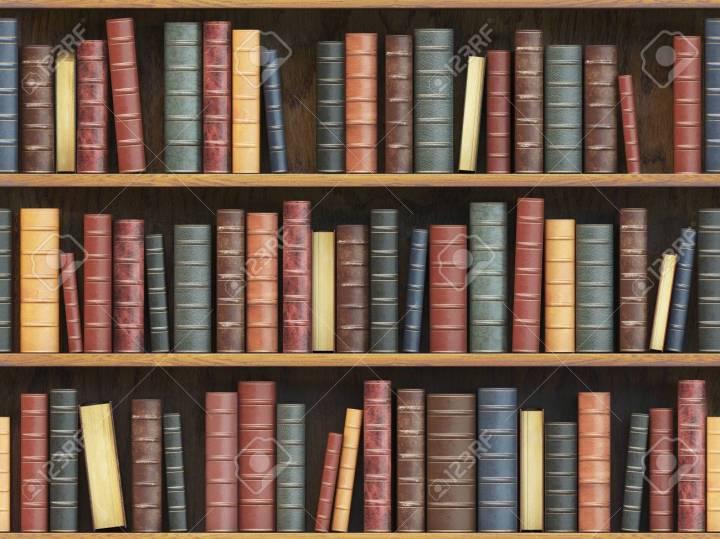 Vintage books on bookshelf. Old books tiled seamless texture bac